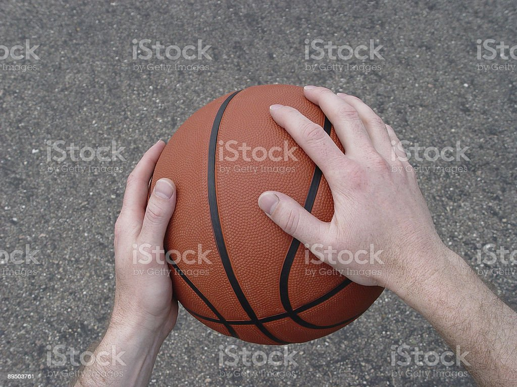 Basketball in hands royalty free stockfoto