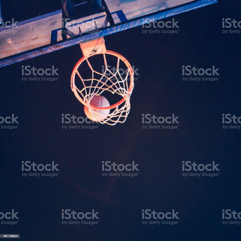 Basketball in hoop stock photo