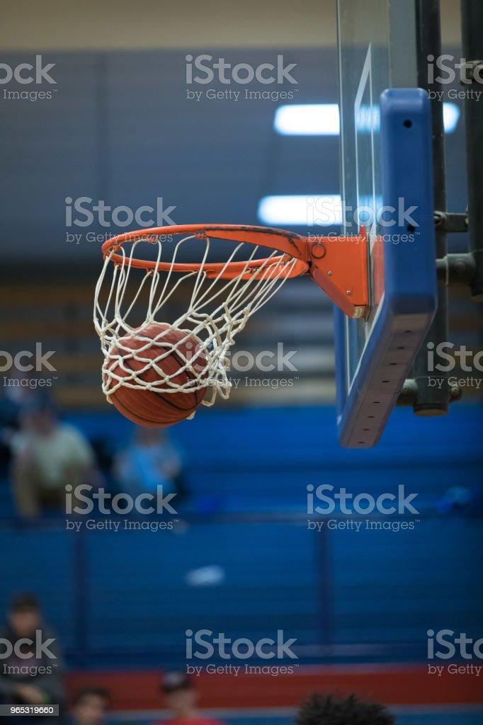 Basketball in net for score zbiór zdjęć royalty-free