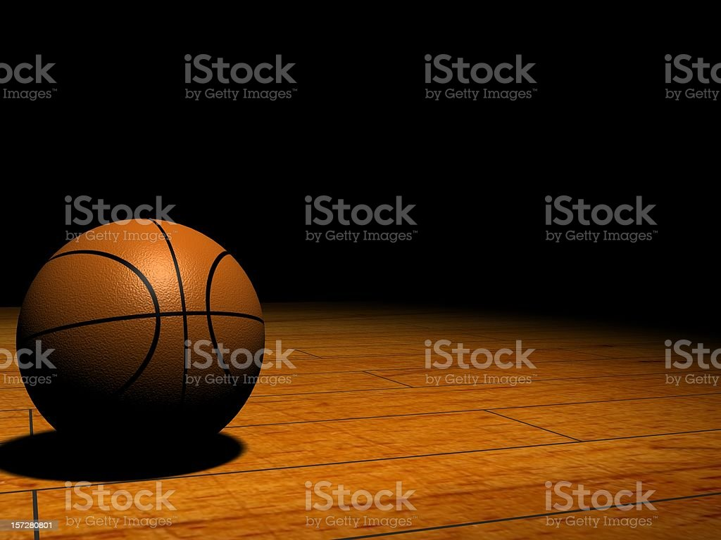 Basketball in the Spotlight stock photo