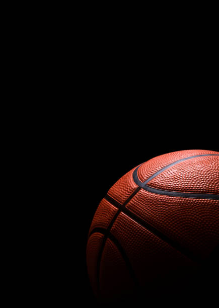 Basketball isolated on black stock photo