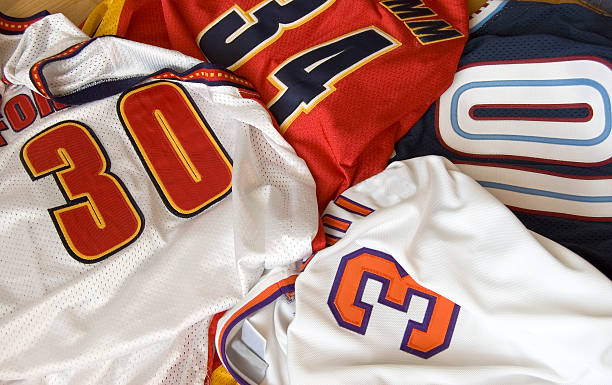 basketball jerseys - sports uniform stock photos and pictures