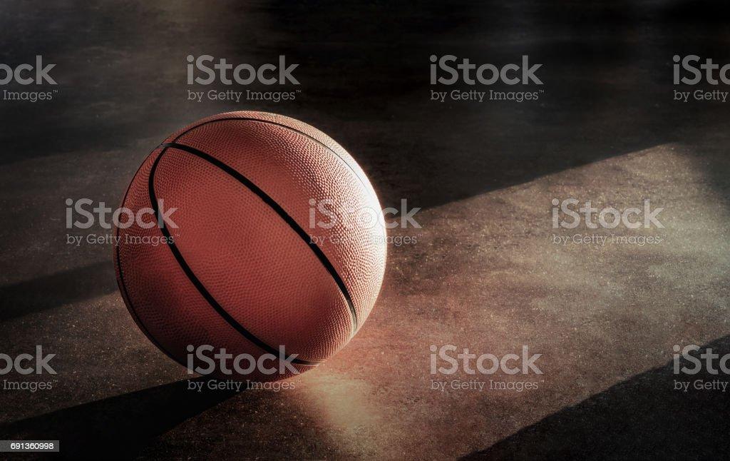 Basket-ball gisait sur le sol dans une atmosphère solitaire. - Photo