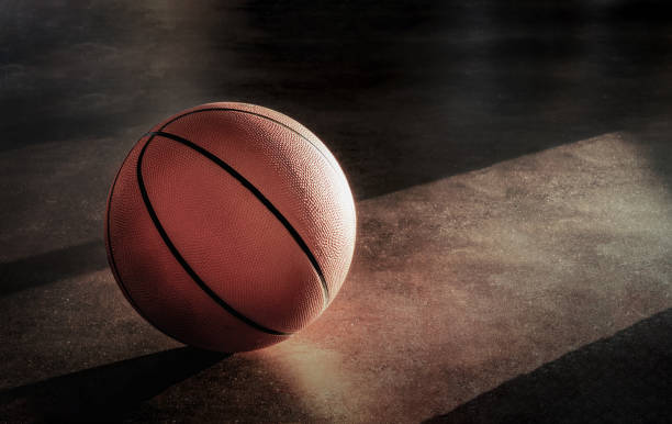 Basketball lay on the floor in a lonely atmosphere. stock photo