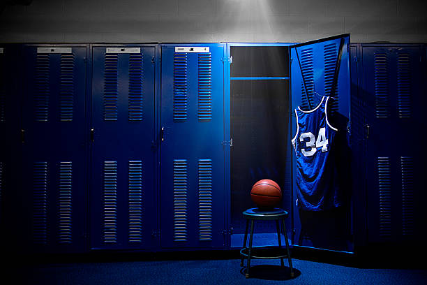 Basketball Locker Room An open locker with a jersey and ball in a authentic basketball locker room. Lots of Copy Space basketball sport stock pictures, royalty-free photos & images