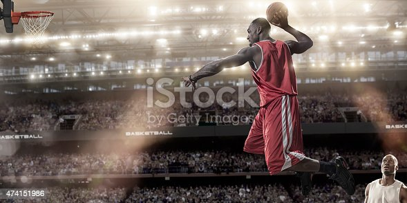 istock Basketball Mid Air Slam Dunk 474151986