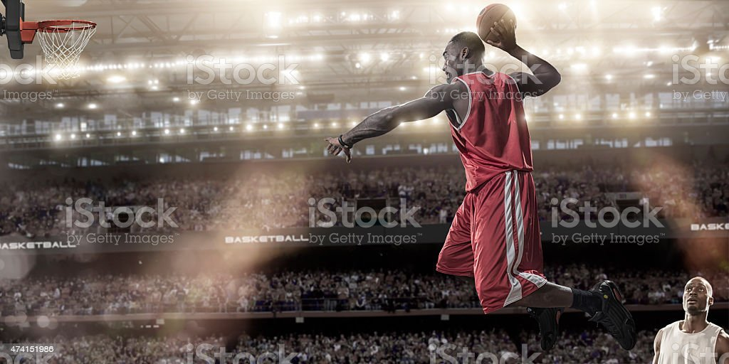 Basketball Mid Air Slam Dunk stock photo