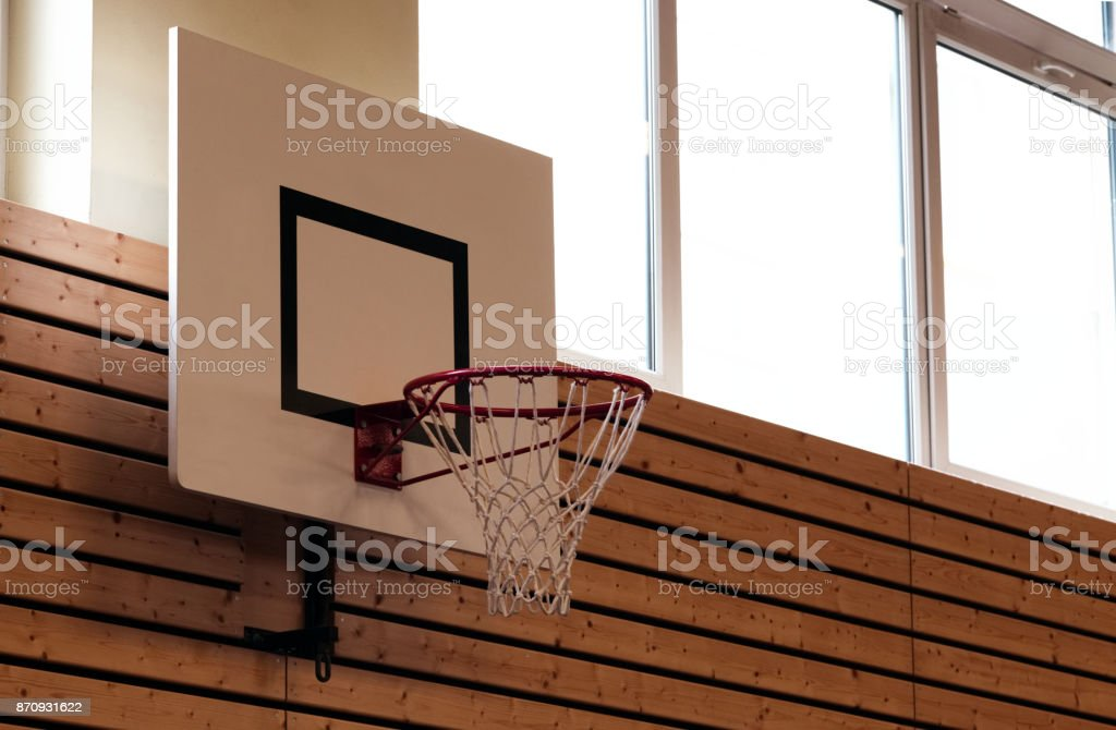basketball net and frame in a school gym sports hall low angle...