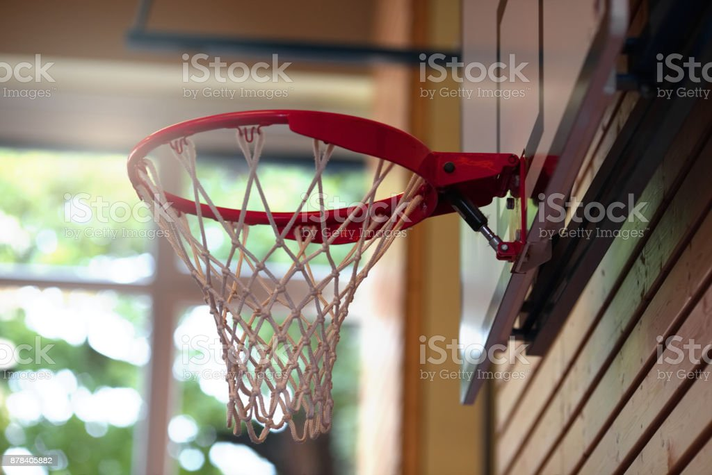 basketball net and frame in a school gym sports hall low angle selective focus.Closeup of basketball hoop background. stock photo