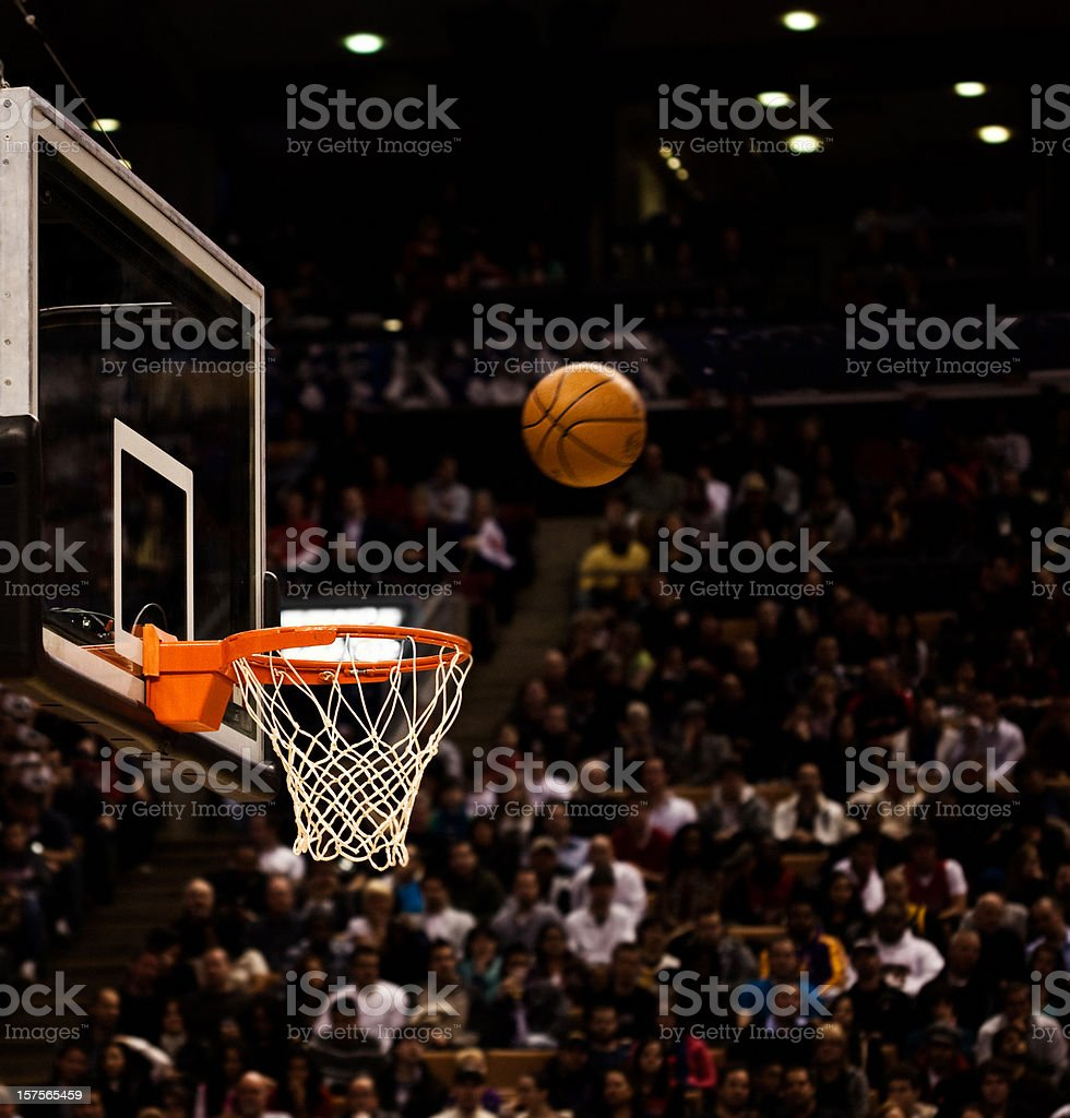 Basketball net with basketball near hoop stock photo