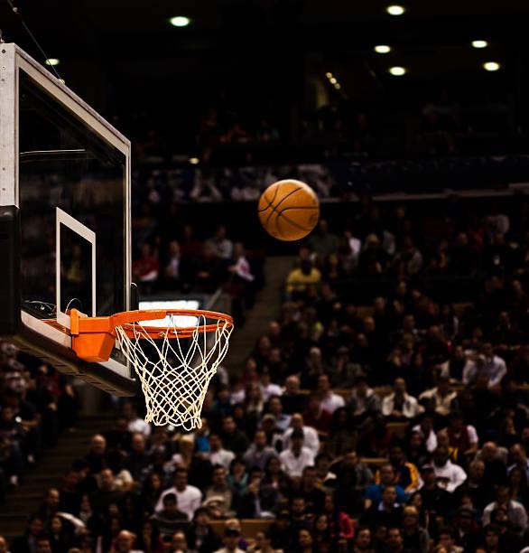 Basketball net with basketball near hoop stock photo