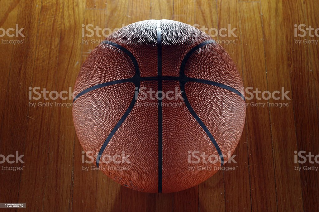 A basketball sits on a hardwood floor. Here is a good link to some...