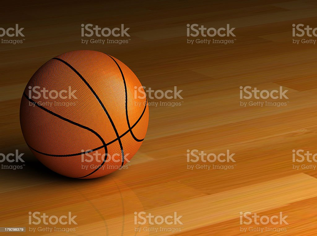 A basketball on a hardwood floor royalty-free stock photo