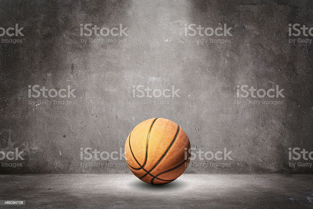 Basketball on a textured wall. stock photo