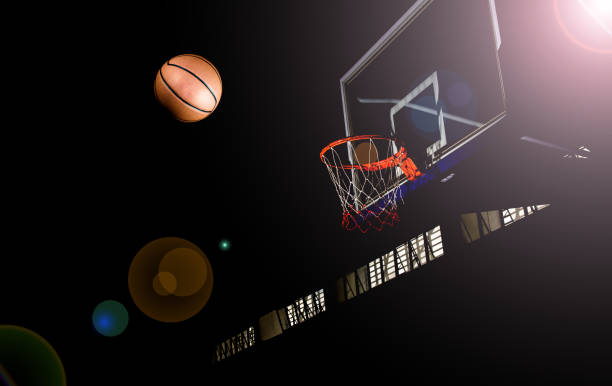 Basketball on black background with light effect stock photo