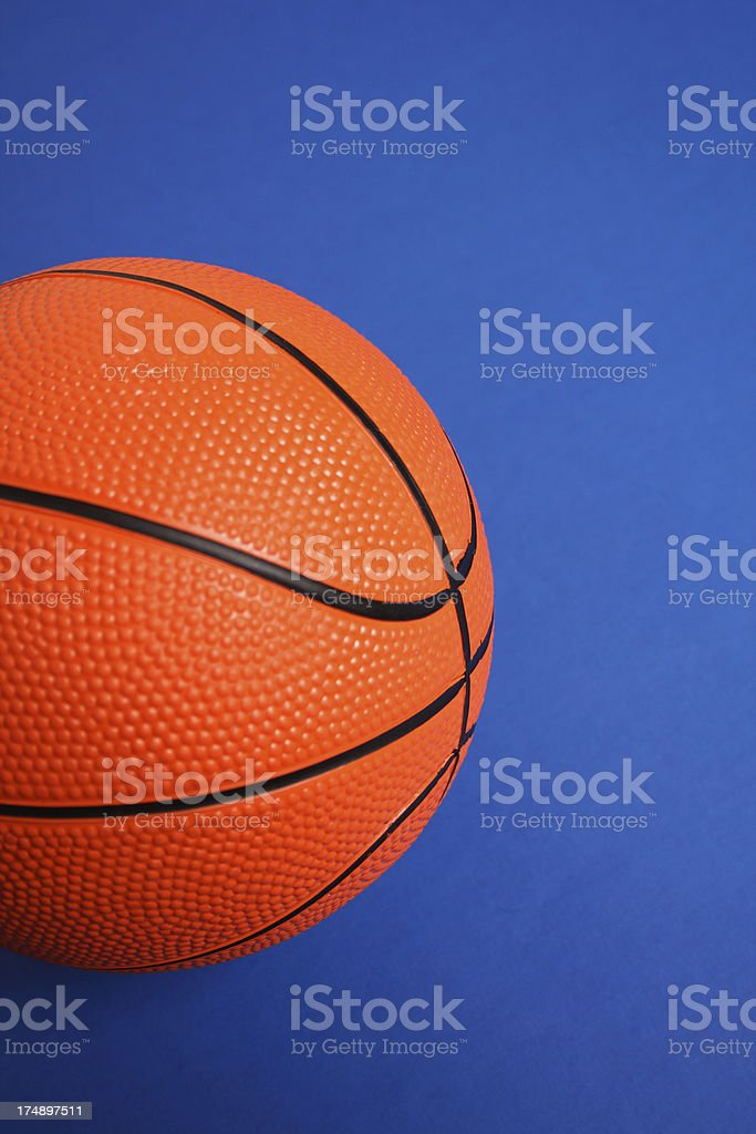 Basketball on blue background royalty-free stock photo