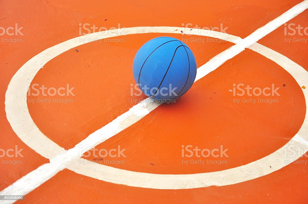 Basketball on Court Floor close up stock photo