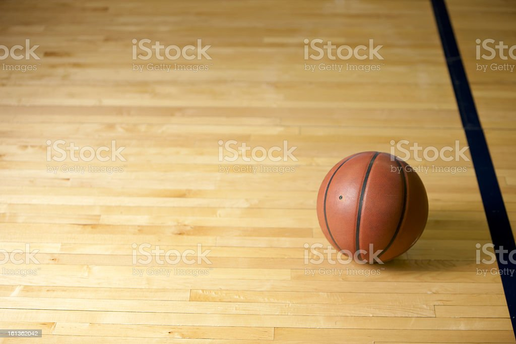 Basketball on the Floor of Court stock photo