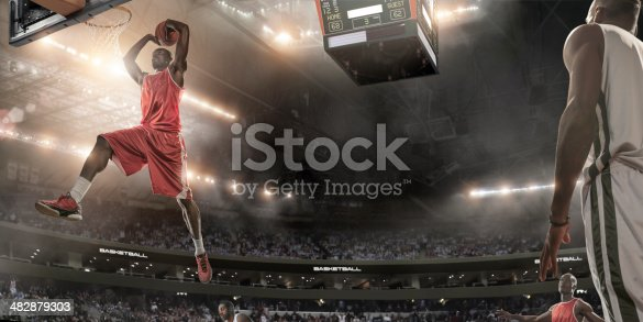 istock Basketball Player About To Slam Dunk 482879303