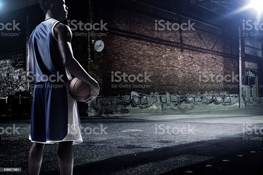 Basketball player at an outdoor place stock photo