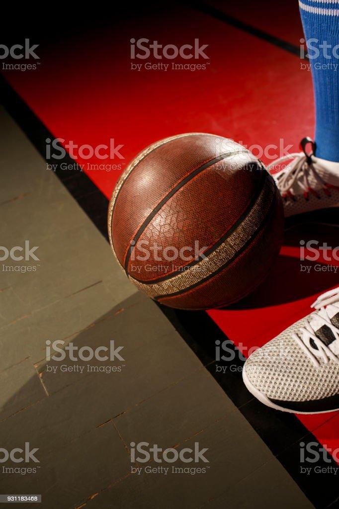 Basketball player Basketball ball on court floor