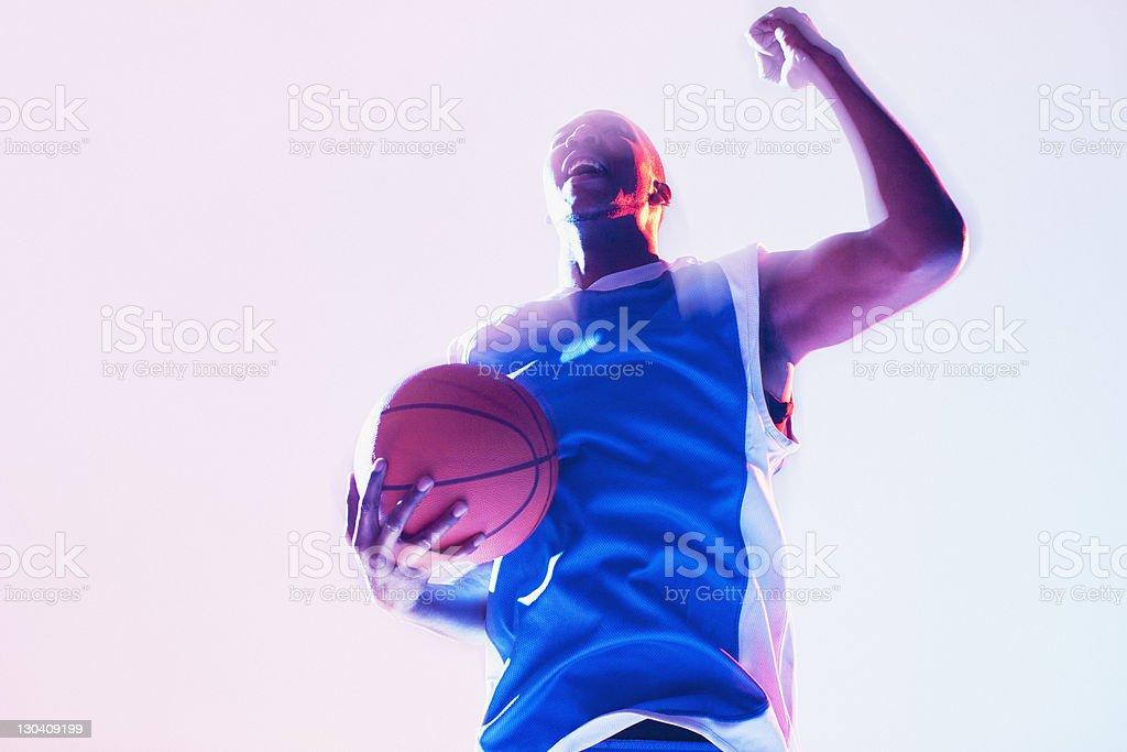 Basketball player cheering royalty-free stock photo