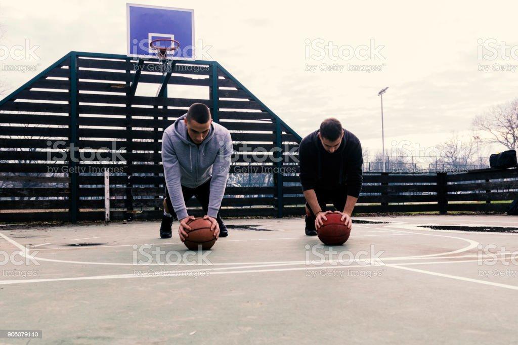 Basketball player doing push ups stock photo