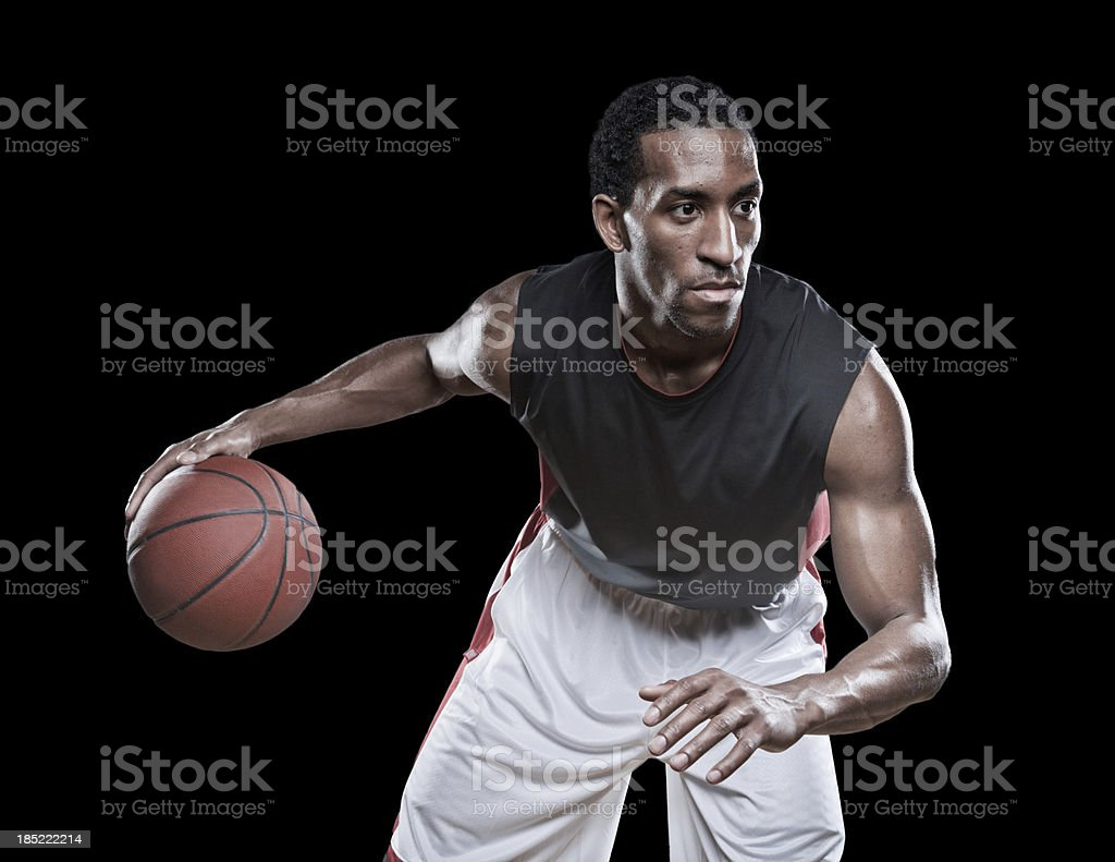 Basketball player dribbling a ball stock photo