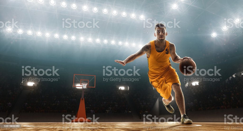 Basketball player dribbling stock photo