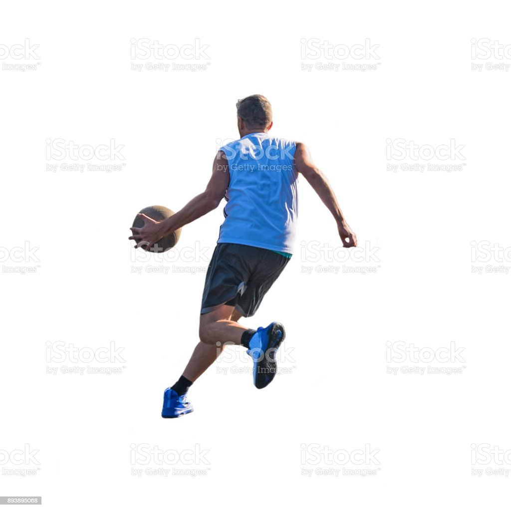 Basketball player dribbling to the basket stock photo