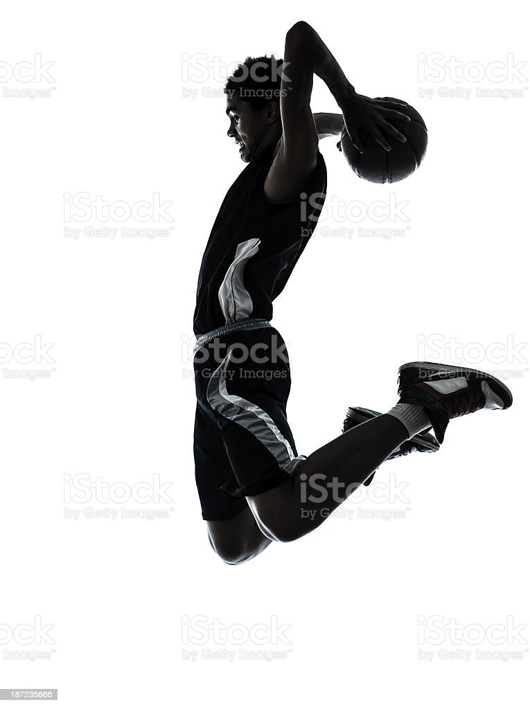 basketball player dunking silhouette stock photo