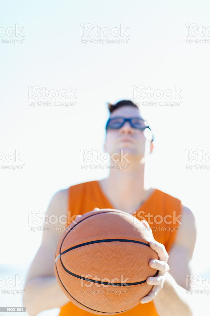 Basketball player focuses before the shooting in the hoop