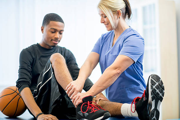 Basketball Player Getting Physical Therapy stock photo
