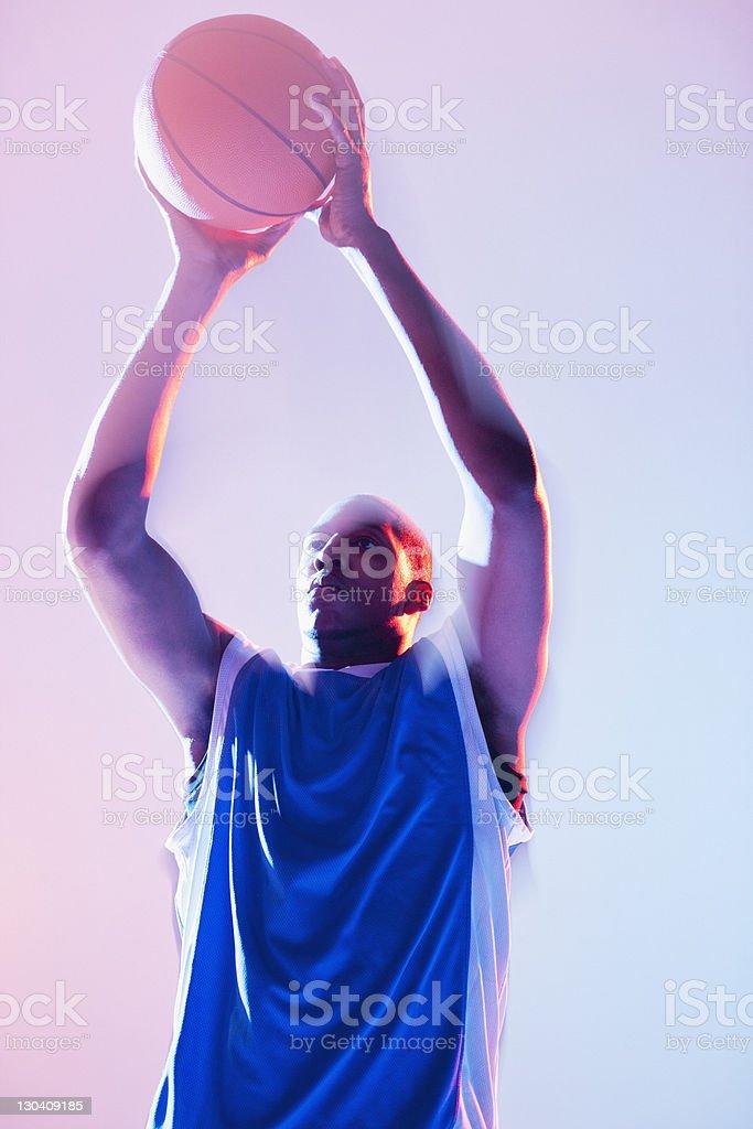 Basketball player holding ball royalty-free stock photo