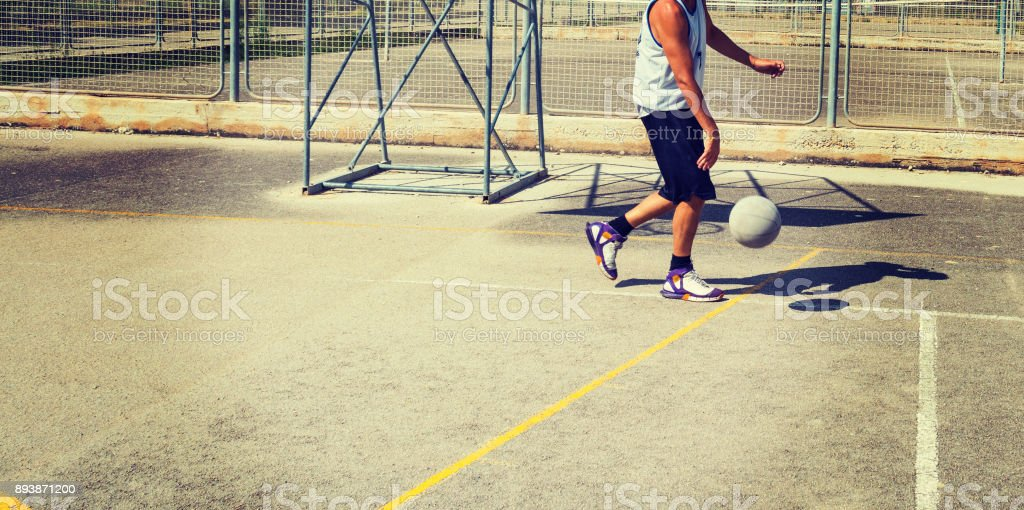 Basketball player in a playground in vintage tone stock photo