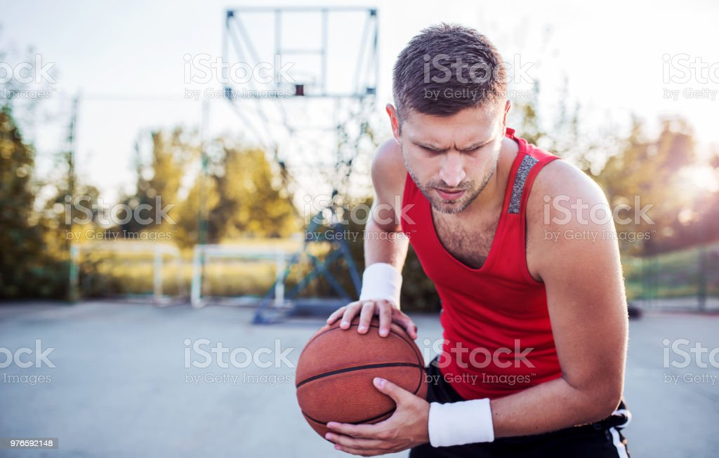 Basketball. Young basketball player exercising on the court. Sport,...