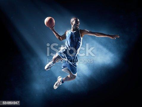 istock Basketball player in jump shot 534864947