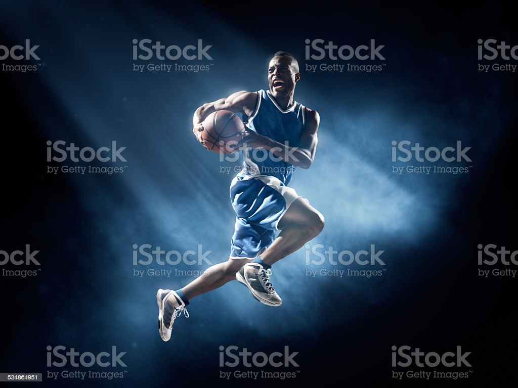 Basketball player in jump shot stock photo