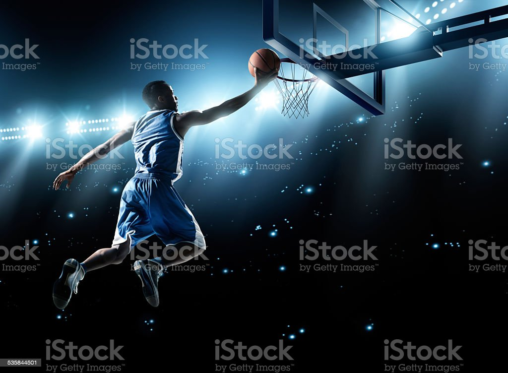 Basketball player in jump shot stok fotoğrafı