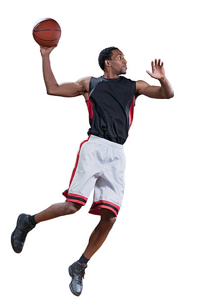 Basketball player in mid-air doing a jump shot Basketball player in mid-air jumping to do a slam dunk jump shot stock pictures, royalty-free photos & images