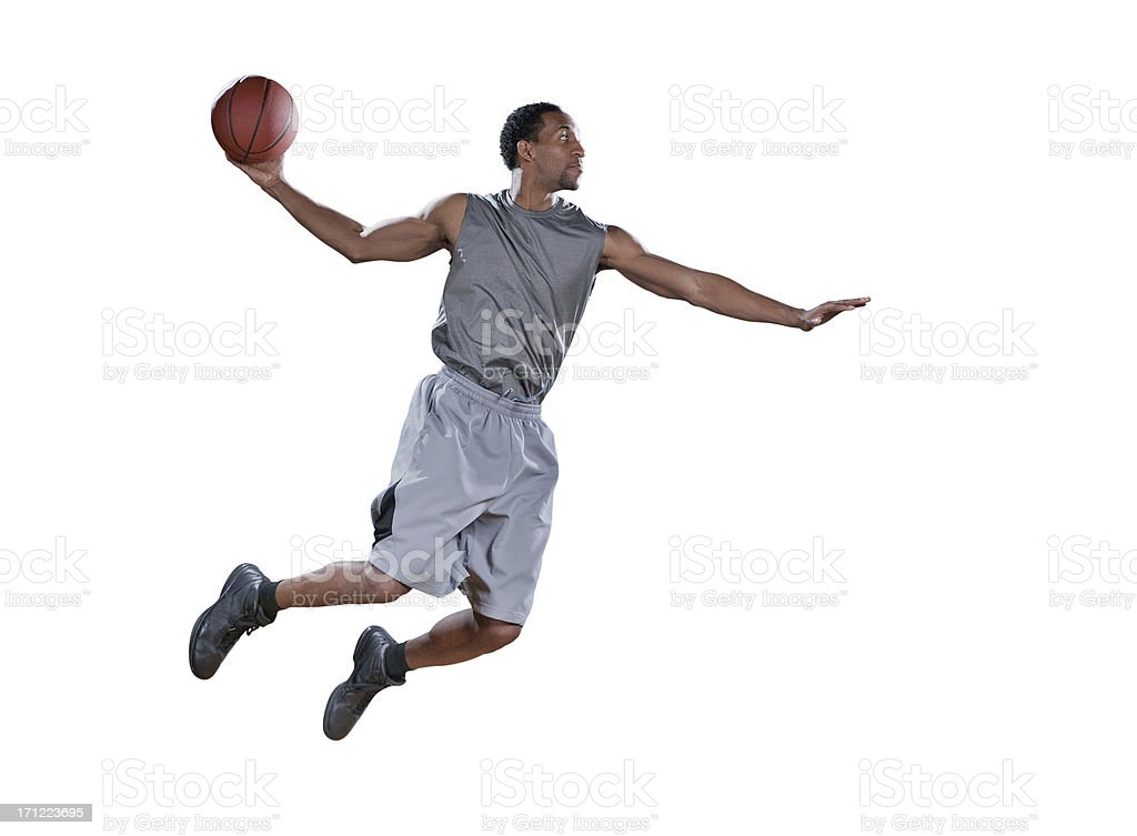 Basketball player in mid-air doing a jump shot royalty-free stock photo