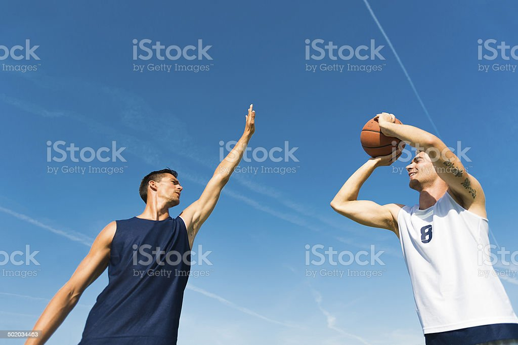 Basketball player in shooting  action royalty-free stock photo