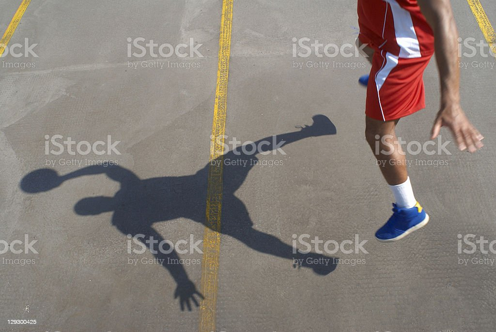 Basketball player jumping with ball royalty-free stock photo