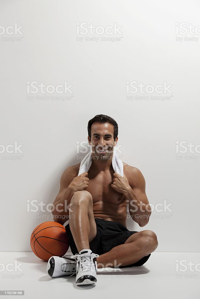 Basketball player leaning agaisnt a wall royalty-free stock photo