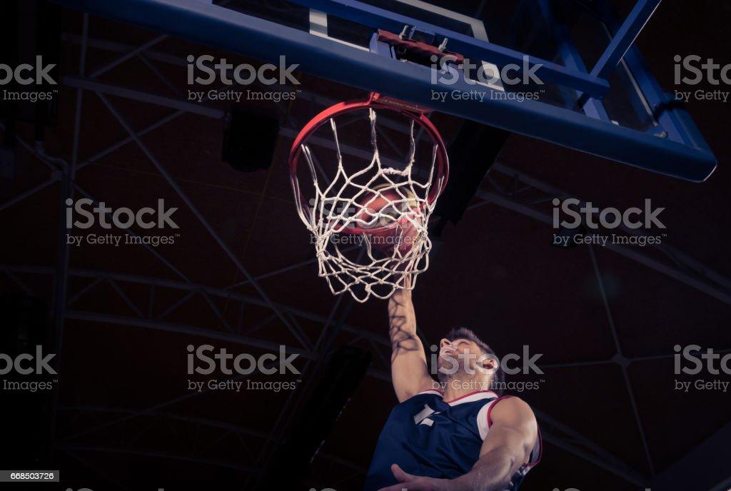 basketball player, low angle view, slam dunk stock photo