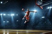 istock Basketball player makes slam dunk 539208441