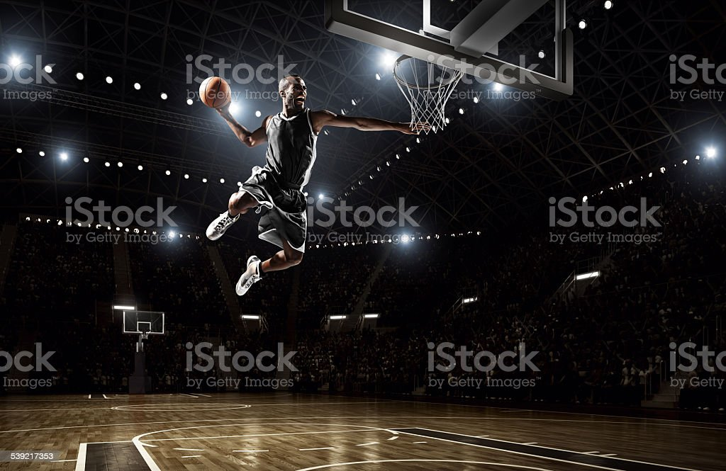 Basketball player makes slam dunk stok fotoğrafı