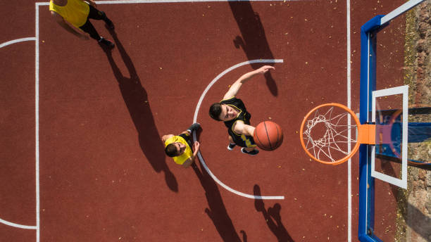 Basketball player making Slam dunk stock photo
