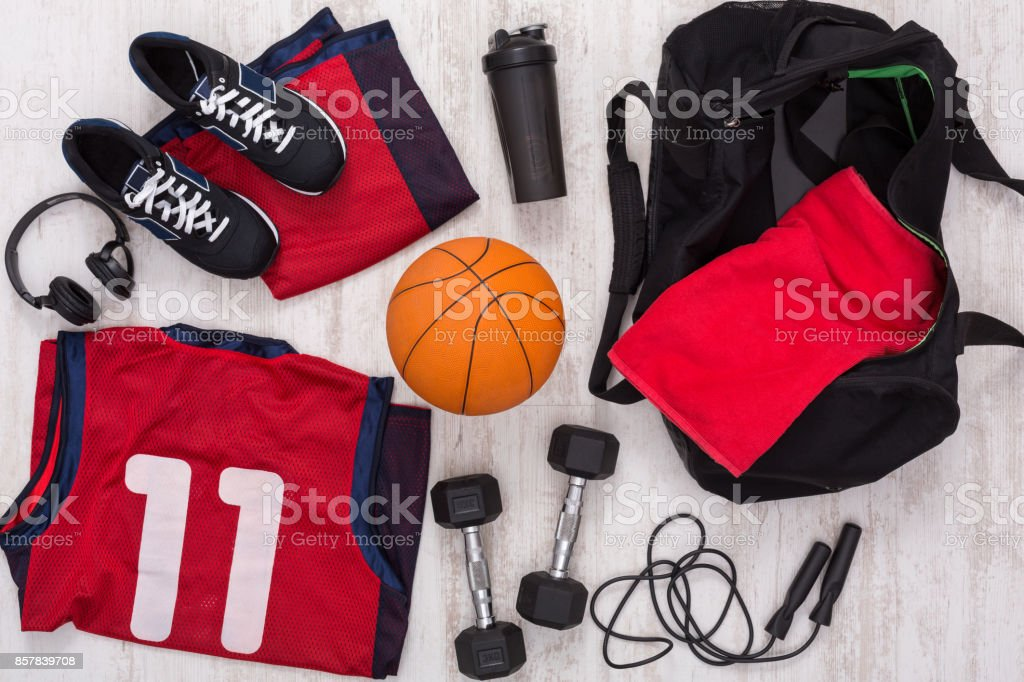 Basketball player outfit background top view. Set of fitness male...
