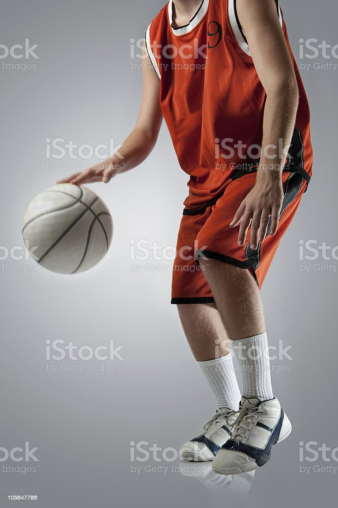 Basketball player dribbling the ball.